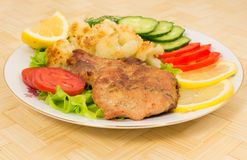 Grilled pork chop with a side dish of cauliflower and vegetables Royalty Free Stock Photos