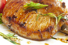 Grilled pork chop with spices stock photography