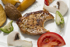 Grilled pork chop with steak fries in shel,l mixed vegetable rag Royalty Free Stock Photos