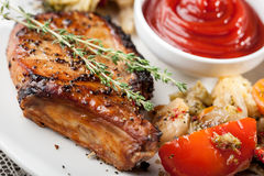 Grilled pork chop and steamed vegetables Royalty Free Stock Photos