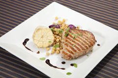 Grilled pork chop w peas and garlic Royalty Free Stock Images