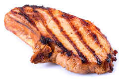 Grilled pork chop on white background. close-up Stock Photography