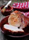 Grilled pork chop on a wooden background Stock Image