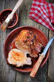 Grilled pork chop on a wooden background Royalty Free Stock Images