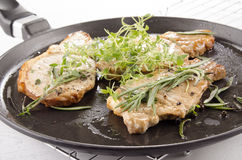 Grilled pork chops with herbs Royalty Free Stock Photos