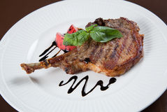 Grilled Pork chops. Meat on the bone. Stock Photos