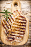 Grilled pork chops pieces. Spices and rosemary. Royalty Free Stock Photo