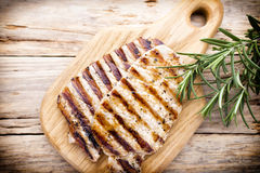 Grilled pork chops pieces. Spices and rosemary. Royalty Free Stock Image