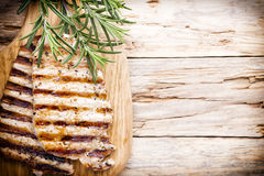 Grilled pork chops pieces. Spices and rosemary. Stock Photos