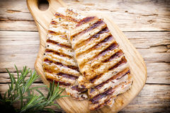 Grilled pork chops pieces. Spices and rosemary. Royalty Free Stock Images