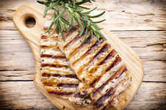 Grilled pork chops pieces. Spices and rosemary. Royalty Free Stock Photography