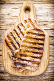 Grilled pork chops pieces. Spices and rosemary. Stock Images