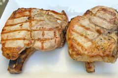 Grilled Pork Chops. On a platter stock photos