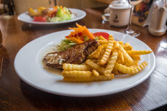 Grilled Pork Chops with Potato and Salad. Lithuanian Cuisine and Food. Royalty Free Stock Photos