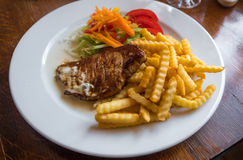 Grilled Pork Chops with Potato and Salad. Lithuanian Cuisine and Food. Stock Photography