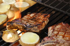 Grilled Pork Chops and Potatoes Stock Photography