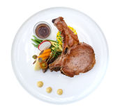 Grilled Pork Chops steak in ceramic plate isolated on white back Royalty Free Stock Image