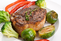 Grilled Pork Chops with Vegetables Stock Image