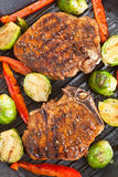 Grilled Pork Chops with Vegetables royalty free stock image