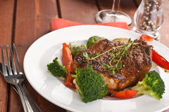 Grilled Pork Chops with Vegetables stock photo
