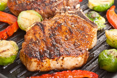 Grilled Pork Chops with Vegetables Stock Photography