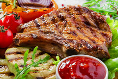 Grilled Pork Chops. With vegetables stock photography