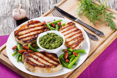 Grilled pork chops on a white dish Stock Image