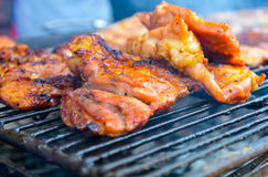 Grilled pork. Close up of grilled pork on the grill at market in Thailand royalty free stock image