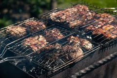 Grilled pork are cooked outdoors, summer picnic. Close-up, copy space, background royalty free stock photography