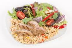 Grilled Pork & Couscous. Stock Photos
