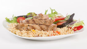 Grilled Pork & Couscous. Stock Image