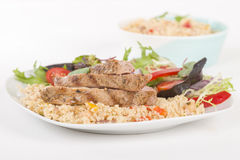 Grilled Pork & Couscous. Royalty Free Stock Photography