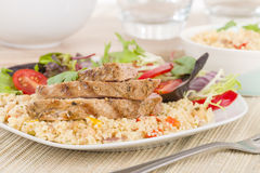 Grilled Pork & Couscous. Stock Photo
