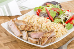 Grilled Pork & Couscous. Stock Photography