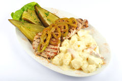 Grilled pork with cucumber and cheese Stock Image