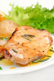 Grilled pork cutlet with orange sauce Stock Photography
