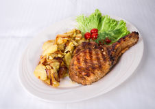 Grilled pork cutlet with potatoes. Stock Photography