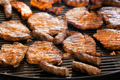 Grilled pork cutlets,on the grillage Stock Photos