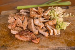 Grilled pork on a cutting board royalty free stock photography