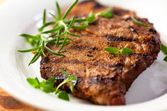 Grilled pork with fresh herbs royalty free stock photography
