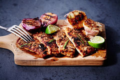 Grilled Pork with Garlic and Red Onions Stock Photos