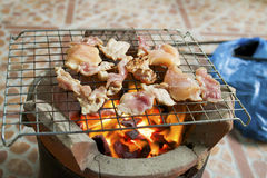 Grilled pork on the grill and black pepper Stock Photo