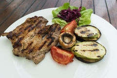 Grilled pork with grilled vegetables Royalty Free Stock Photos