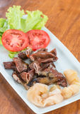 Grilled pork intestines. For food background Royalty Free Stock Photography
