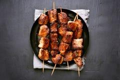 Grilled pork kebabs on dark background, top view Stock Images