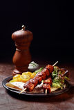 Grilled pork kebabs with salad and tortilla Stock Photos