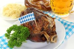 Grilled pork knuckle. A knuckle with pretzels and parsley on a white background Stock Photo
