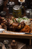 Grilled pork knuckle with sauerkraut. For a big company Royalty Free Stock Images