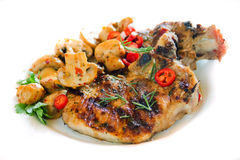 Grilled pork loin chops. With mushrooms isolated on white Stock Photography