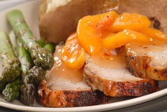 Grilled pork loin with peach sauce Stock Photography